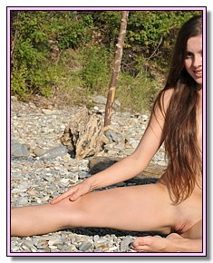 sultry young female nudists completely undresses In the company of nudists on the beach