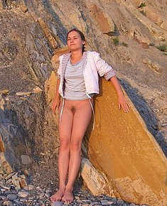sexy young female naturists gets warm for her ass on the private beach