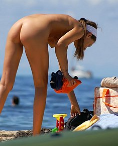 without complexes nudists teenagers seduces men on a sandy beach