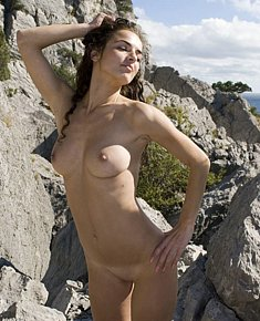 undressed young nymphomaniac seduces men on the beach near the sea