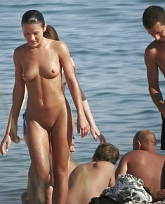 With bald pussy young female nudists enjoys being naked at florida nude beaches