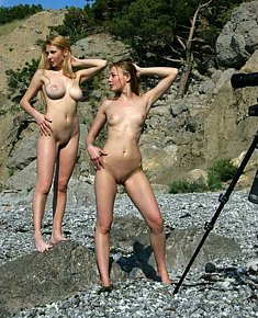 relaxed young ladies enjoys nudist life on nude beach in turkey