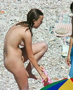 dissolute naked teeny girls relaxes without clothes on nude beach in turkey