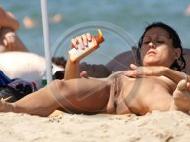 Sprread legs on nude beach