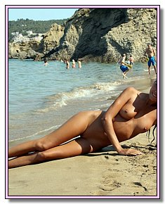 alluring young bitches flirts naked on a hot sand