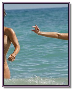 shapely nudists teenagers admires itself on a sandy beach