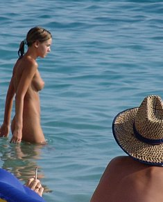 beautiful young nudists enjoys being naked near beach resort jamaica