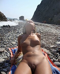 lazy nudist girlfriend attracts men on a nudist beach