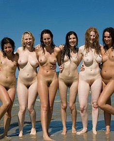 lovely young female naturists offers pussy for sun on a sandy beach