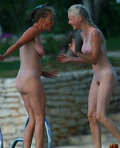 smeared with cream various nudists chicks sunbathes without panties at beach among men