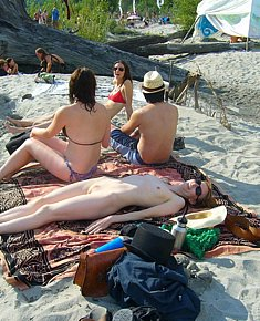 With bald pussy young female nudists spreads legs on nude beach in turkey