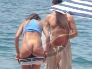 Changing their bikinis at nude beach