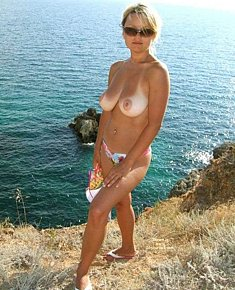 sunburned blonds and brunet girls disclaims swimwear on ukraine nude beach